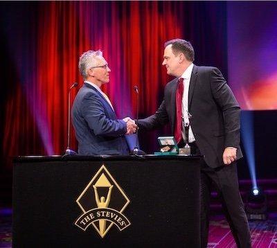Jeffrey Deckman accepting Stevie Awards